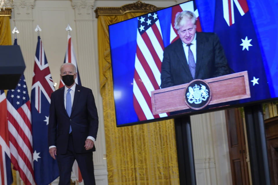 President Joe Biden, arrives and is joined virtually by Australian Prime Minister Scott Morrison and British Prime Minister Boris Johnson, right, to speak about a national security initiative from the East Room of the White House in Washington, Wednesday, Sept. 15, 2021. (AP Photo/Andrew Harnik)