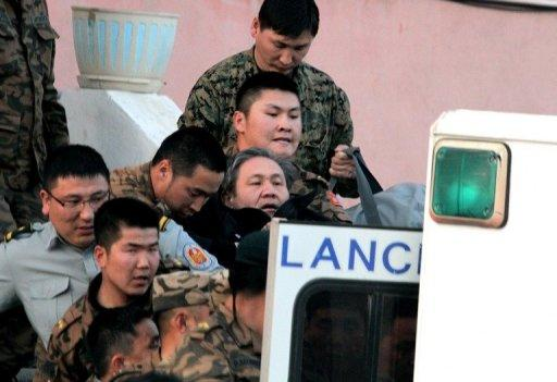 Former Mongolian leader Nambar Enkhbayar (C) is removed from his home in Ulan Bator in April 2012, after he was arrested on orders from Mongolia's anti-graft watchdog. The court jailed the former president for four years after finding him guilty of corruption charges that he has called politically motivated