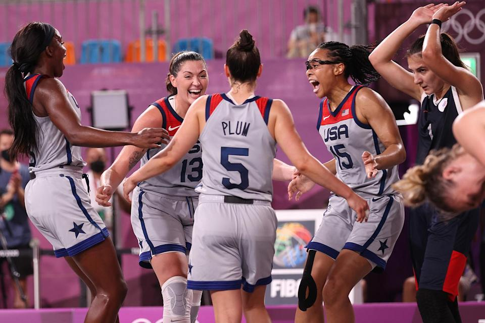 <p>Team USA's Jacquelyn Young, Stefanie Dolson, Kelsey Plum and Allisha Gray embrace as they win gold in the 3x3 Basketball competition at Aomi Urban Sports Park on July 28.</p>