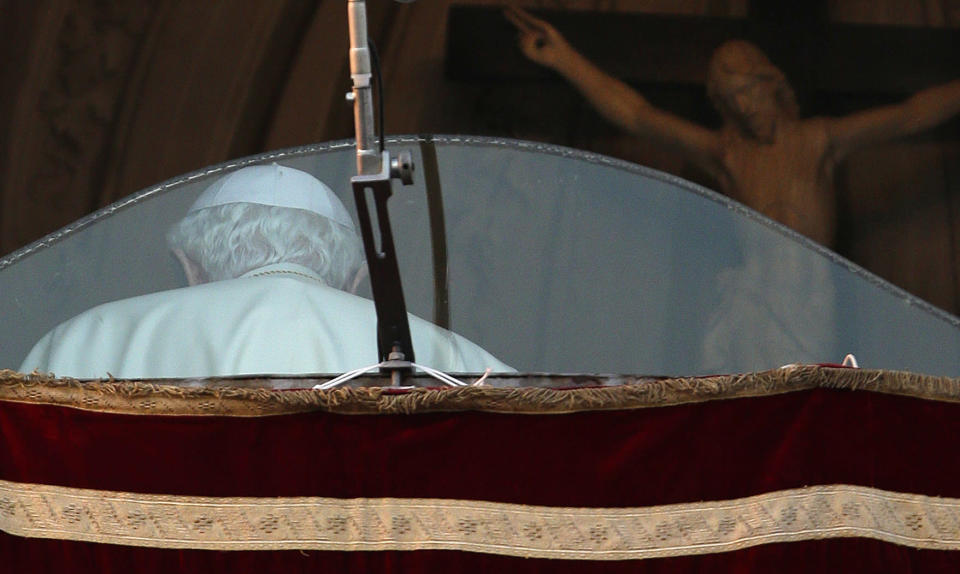 Pope Benedict XVI walks away after addressing the crowd from the window of the Pope's summer residence of Castel Gandolfo, the scenic town where he will spend his first post-Vatican days and make his last public blessing as pope,Thursday, Feb. 28, 2013. (AP Photo/Andrew Medichini)