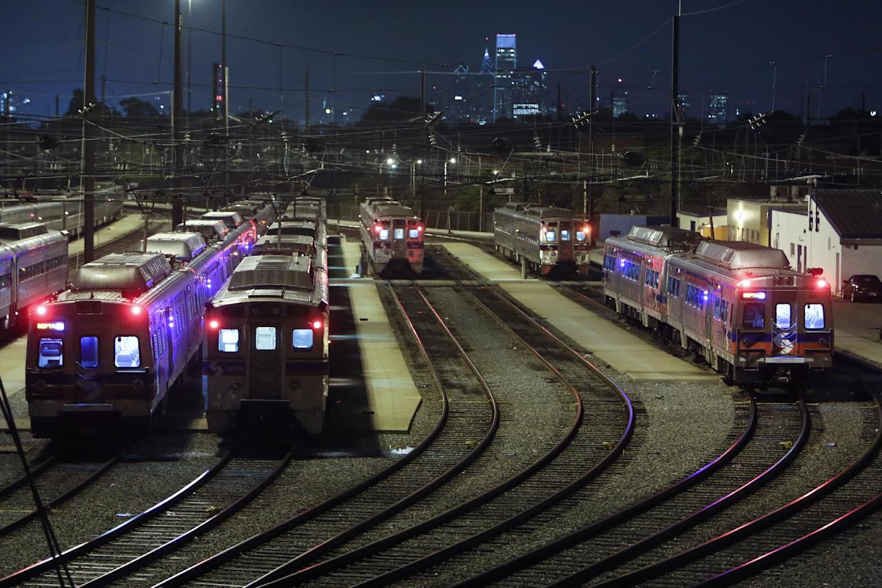 Commuter rail trains sit parked at the Roberts Avenue rail yard in Philadelphia on Saturday June 14, 2014, after members of the Brotherhood of Locomotive Engineers and Trainmen (BLET) union went on strike at 12:01 a.m. Saturday. (AP Photo/ Joseph Kaczmarek)