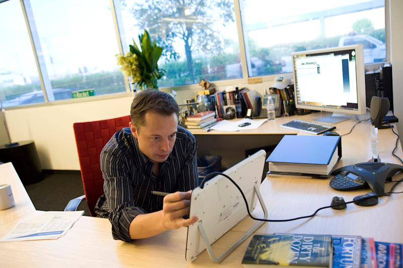 SpaceX and Tesla CEO Elon Musk works at his desk in 2008.