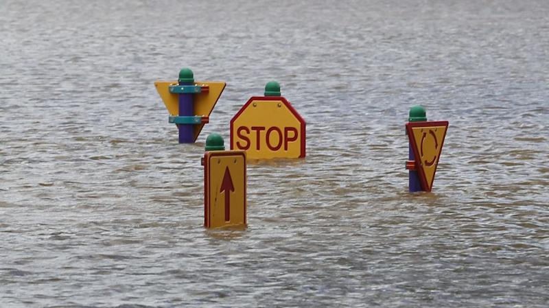 A play ground affected by flooded waters is seen in Bundaberg, Queensland