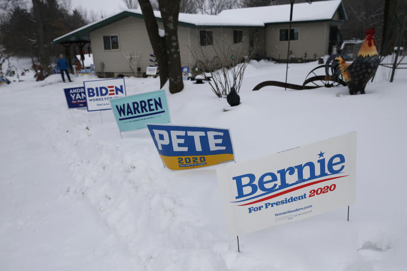 WAVERLY, IA - JANUARY 25: Yard signs for Andrew Yang, Joe Biden, Elizabeth Warren, Pete Buttigieg, and Bernie Sanders are seen in Jim Monaghan's front yard in Waverly, IA on Jan. 25, 2020. All across this frozen, snow-covered state, folks are grinding their teeth and griping to one another about the inescapable onslaught of text messages, TV ads, and mailboxes stuffed with political literature. The campaign phone calls have been endless. Social media feeds are so jammed with messaging that it can be impossible to scroll through family photos on Facebook without enduring the pleading overtures of the various Democratic hopefuls. Its only grown worse as next Mondays caucus approaches.