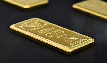 A 1000 gram gold bar is seen at the Kazakhstan's National Bank vault in Almaty