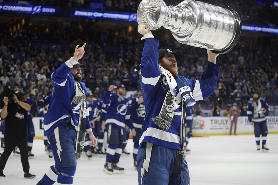 FILE - In this July 7, 2021, file photo, Tampa Bay Lightning center Brayden Point hoists the Stanley Cup after the team defeated the Montreal Canadiens in Game 5 of the NHL hockey Stanley Cup finals in Tampa, Fla. (AP Photo/Phelan Ebenhack, File)