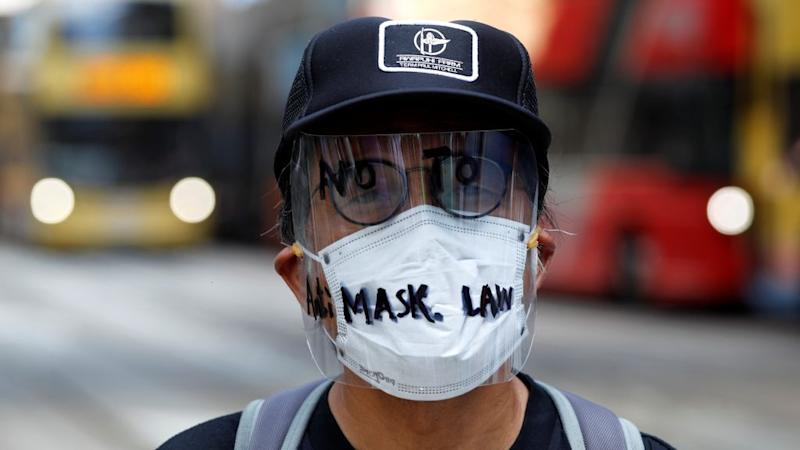 An anti-government protester wearing a mask attends a lunch time protest, after local media reported on an expected ban on face masks under emergency law, at Central, in Hong Kong, China, October 4, 2019.