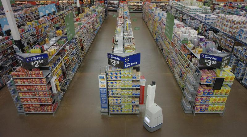 Wal-Mart Stores Inc's shelf-scanning robots replenish inventory to save employees time when products run out as seen in this handout photo