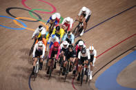 Athletes compete during the track cycling men's omnium elimination race at the 2020 Summer Olympics, Thursday, Aug. 5, 2021, in Izu, Japan. (AP Photo/Christophe Ena)
