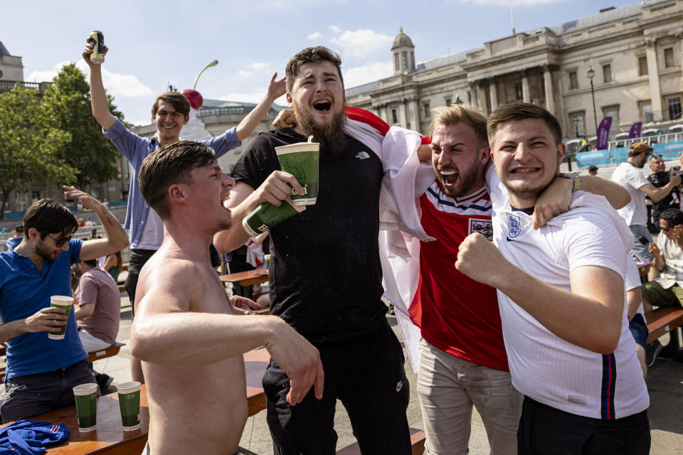LONDON, ENGLAND - JUNE 13: Football fans at a fan zone in Trafalgar Square celebrate the win as the final whistle goes in England's opening game against Croatia on June 13, 2021 in London, England. Fanzones and pubs are hosting England fans around the country as England take on Croatia at Wembley in the first game of Euro 2020. (Photo by Rob Pinney/Getty Images)
