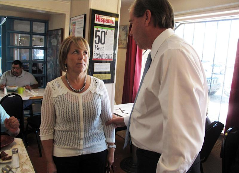 This photo taken Oct. 19, 2012 shows New Mexico Democratic Congressional candidate Michelle Lujan Grisham, talking with Sen. Tom Udall, D-N.M. at Barelas Coffee House in Albuquerque, N.M. A total of 49 Latino candidates _ 32 Democrats, 16 Republicans and one without a declared party _ are seeking House seats this year, according to the bipartisan National Association of Latino Elected and Appointed Officials. Depending on how many of them win, their numbers in the House could make history. (AP Photo/Russell Contreras)