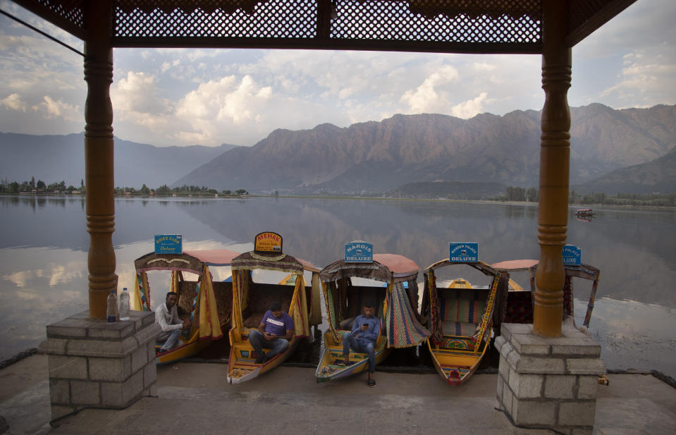 Kashmiri boatmen rest as they wait for customers on the deserted banks of the Dal Lake in Srinagar, Indian controlled Kashmir, July 20, 2020. The region's economy is yet to recover from a colossal loss a year after New Delhi scrapped the disputed region's autonomous status and divided it into two federally governed territories. (AP Photo/Mukhtar Khan)
