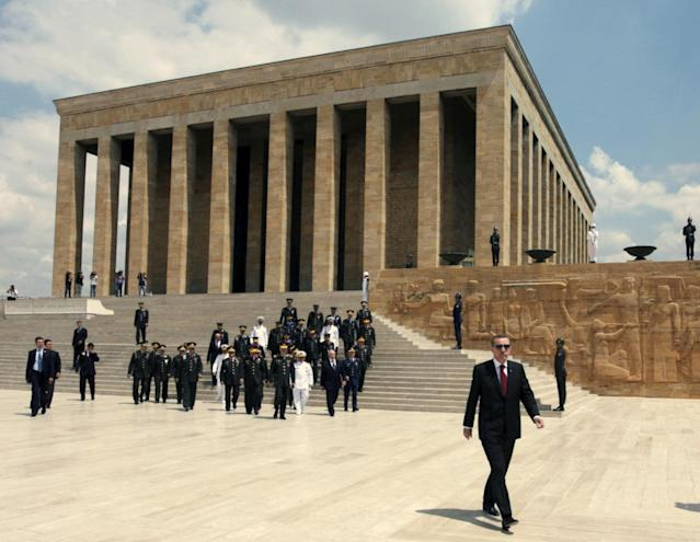 <p>Turkish Prime Minister Recep Tayyip Erdogan, right, Chief of Staff Gen. Ilker Basbug and commanders follow a guard of honor, not seen, at the mausoleum of modern Turkey's founder Kemal Ataturk in Ankara, Turkey, Saturday, Aug. 1, 2009. Erdogan joined top commanders for military's highest annual meetings to promote officers or dismiss others for disciplinary reasons. (AP Photo/Burhan Ozbilici) </p>