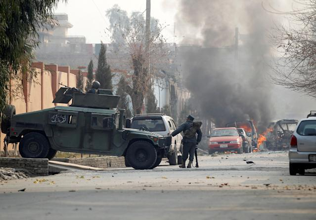 <p>Afghan police officers arrive at the site of a blast and gun fire in Jalalabad, Afghanistan, Jan. 24, 2018. (Photo: Parwiz/Reuters) </p>