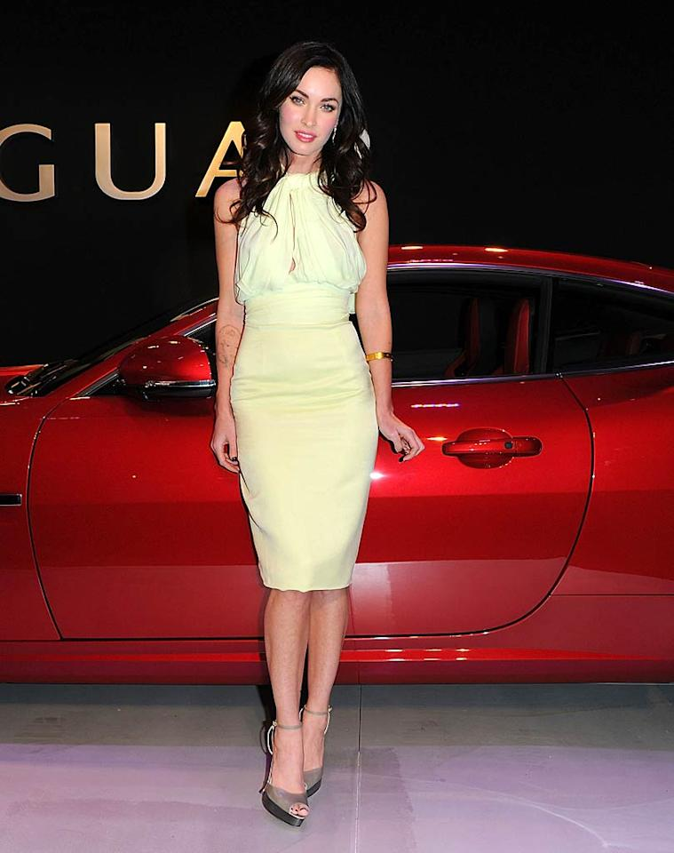 "Megan Fox has been MIA for months, but the former ""Transformers"" star made a triumphant return to the spotlight at Jaguar's 50th anniversary fete in a magnificent, mint Juan Carlos Obando halter dress, Brian Atwood platform peep-toes, and a single gold bangle. Andrew H. Walker/<a href=""http://www.gettyimages.com/"" target=""new"">GettyImages.com</a> - April 20, 2011"