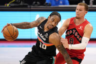 San Antonio Spurs forward DeMar DeRozan (10) drives around Toronto Raptors guard Malachi Flynn (8) during the second half of an NBA basketball game Wednesday, April 14, 2021, in Tampa, Fla. (AP Photo/Chris O'Meara)
