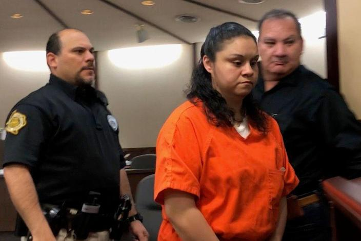 Esmeralda Garza appears in court on April 5, 2019. She plead guilty in court to three counts of selling a child.