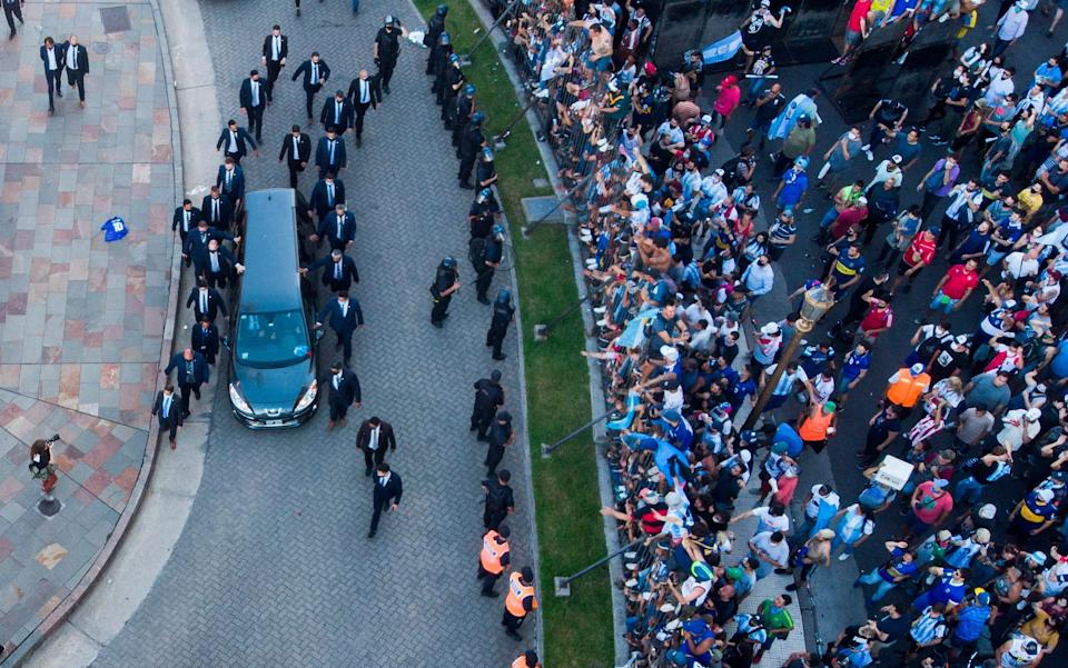 The hearse carrying the casket of Diego Maradona leaves the government house in Buenos Aires - AP Photo/Mario De Fina