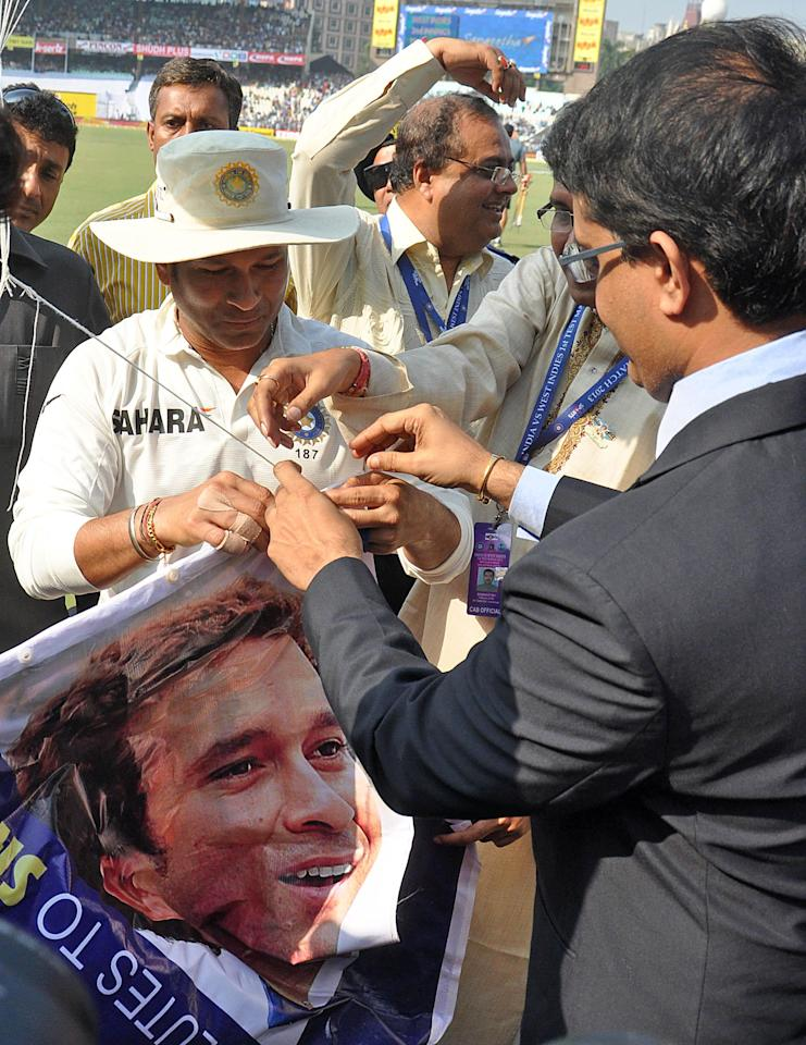 Former Indian cricketer Sourav Ganguly and master blaster Sachin Tendulkar with laters poster during the 3rd day of the 1st test match between India and West Indies at Eden Gardens, Kolkata on Nov. 8, 2013. (Photo: IANS)