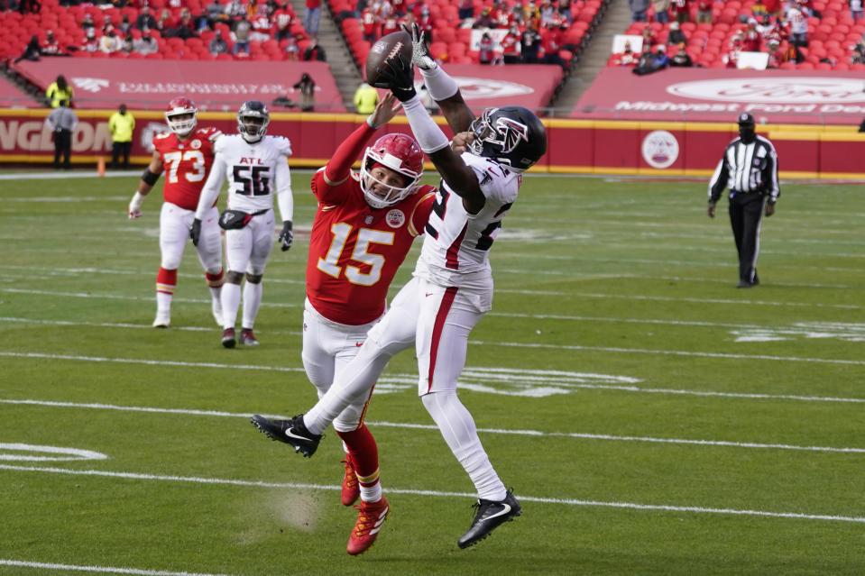 A pass intended for Kansas City Chiefs quarterback Patrick Mahomes is intercepted by Atlanta Falcons safety Keanu Neal during the first half an NFL football game, Sunday, Dec. 27, 2020, in Kansas City. (AP Photo/Jeff Roberson)