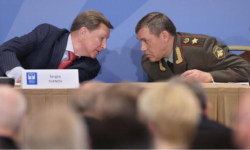 Gen. Valery Gerasimov, the chief of the Russian military's General Staff, right, listens to the Kremlin's chief of staff Sergei Ivanov during a security conference in Moscow, Russia, Thursday, May 23, 2013. The top Russian military officer has warned the West that Moscow reserves the right to take steps in response to the U.S.-led NATO missile defense plans for Europe if it sees it as a threat. (AP Photo/Mikhail Metzel)
