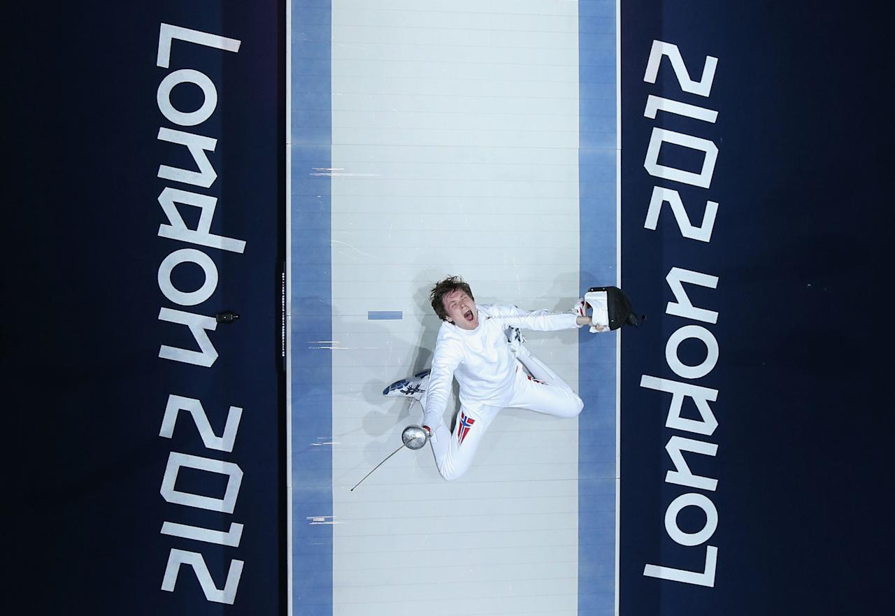 Bartosz Piasecki of Norway celebrates victory against Jinsun Jung of Korea in the Men's Epee Individual Fencing Semi Final on Day 5 of the London 2012 Olympic Games at ExCeL  on August 1, 2012 in London, England.  (Photo by Ian Walton/Getty Images)