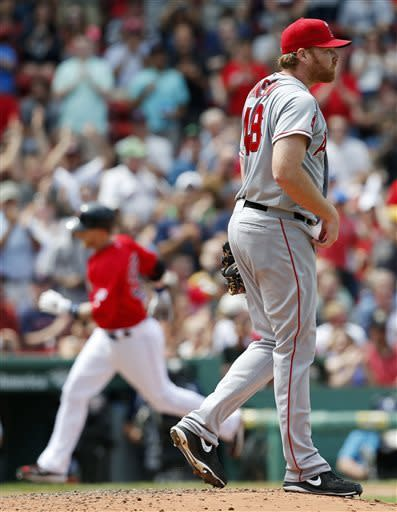 Los Angeles Angels' Tommy Hanson, right, looks to the outfield after giving up a solo home run to Boston Red Sox's Stephen Drew, left, in the fourth inning of the first baseball game of a doubleheader in Boston, Saturday, June 8, 2013. (AP Photo/Michael Dwyer)