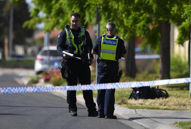 Police are seen at the scene of a stabbing death adjacent to Keilor Plains Station in St Albans in Melbourne.