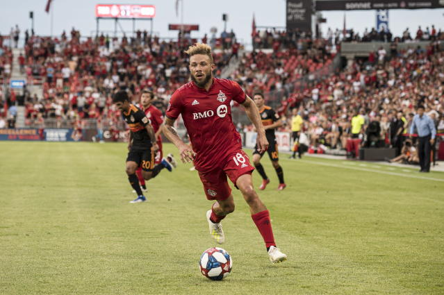 Toronto FC midfielder Nick DeLeon (18) dribbles the ball down field during the first half of an MLS soccer game against the Houston Dynamo, Saturday, July 20, 2019 in Toronto. (Christopher Katsarov/The Canadian Press via AP)