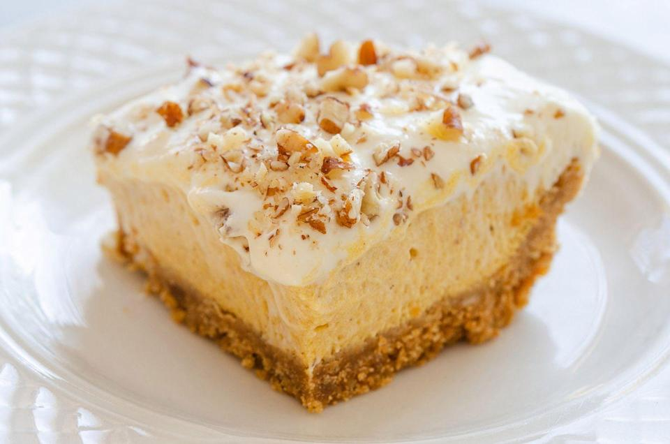 """<p>Graham crackers, powdered sugar, and butter are three of just a handful of ingredients you'll need to make these delicious bars. Can't you almost taste them?</p><p><strong><a href=""""https://thepioneerwoman.com/food-and-friends/pumpkin-cream-cheese-bars/"""" rel=""""nofollow noopener"""" target=""""_blank"""" data-ylk=""""slk:Get the recipe"""" class=""""link rapid-noclick-resp"""">Get the recipe</a>.</strong></p><p><strong><a class=""""link rapid-noclick-resp"""" href=""""https://go.redirectingat.com?id=74968X1596630&url=https%3A%2F%2Fwww.walmart.com%2Fip%2FThe-Pioneer-Woman-Gorgeous-Garden-Dinner-Plates-Set-of-4%2F763327832&sref=https%3A%2F%2Fwww.thepioneerwoman.com%2Ffood-cooking%2Fmeals-menus%2Fg32110899%2Fbest-halloween-desserts%2F"""" rel=""""nofollow noopener"""" target=""""_blank"""" data-ylk=""""slk:SHOP PLATES"""">SHOP PLATES</a></strong></p>"""