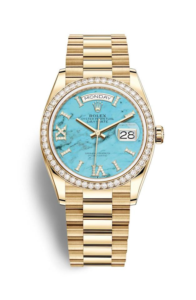 """<p><strong>Rolex</strong></p><p>rolex.com</p><p><a href=""""https://www.rolex.com/watches/day-date/m128348rbr-0037.html"""" target=""""_blank"""">Shop Now</a></p><p>A chic way to tell time? Look to Rolex's Day-Date 36: a stunning turquoise dial, diamond-set bezel, and 18 karat yellow gold bracelet make this timepiece a winning look every time. </p>"""