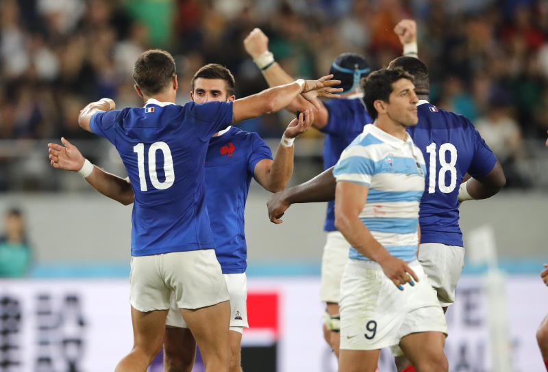 French players embrace after defeating Argentina 23-21 in the Rugby World Cup Pool C game at Tokyo Stadium between France and Argentina in Tokyo, Japan, Saturday, Sept. 21, 2019. (AP Photo/Christophe Ena)