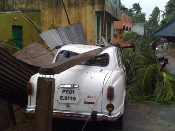 A car crushed by a pole felled by the 140 kph winds that accompanied Cyclone Thane, which made landfall between Puducherry and Cuddalore on India's south eastern coast. Photo by Yahoo! reader Aravindan