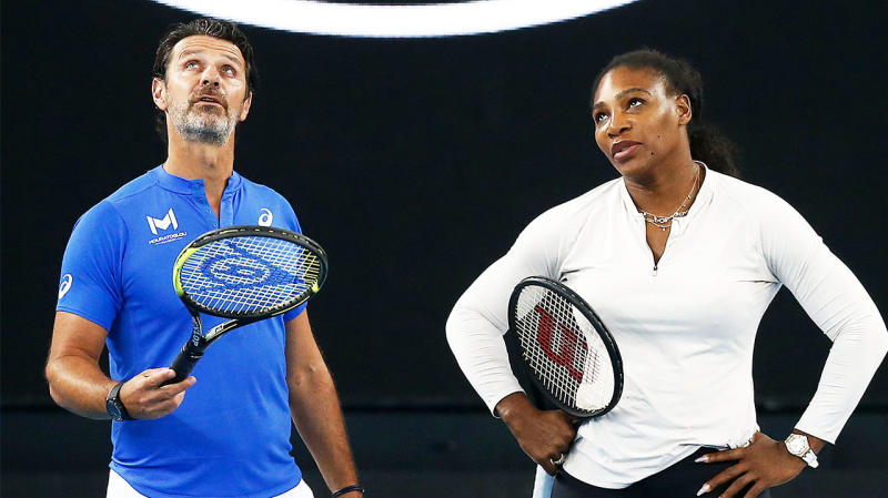 Serena Williams of United States (R) speaks with coach Patrick Mouratoglou during practice ahead of the 2020 Australian Open at Melbourne Park on January 17, 2020 in Melbourne, Australia. (Photo by Daniel Pockett/Getty Images)