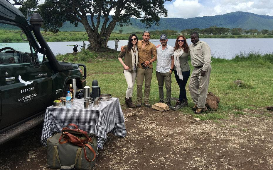 <p>Our crew (minus Robbie) with our awesome andBeyond Safari guide, Peter. Behind us is a hippopotamus watering hole. We stopped for a snack and coffee with Amarula, which is the best type of Baileys you can ever imagine. </p>