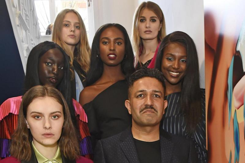 Central attraction: Osman Yousefzada and models (Photo by David M. Benett/Dave Benett/Getty Images for Osman)