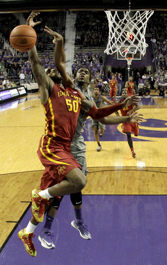 Iowa State's DeAndre Kane (50) is fouled by Kansas State's Nino Williams during the first half of an NCAA college basketball game Saturday, March 1, 2014, in Manhattan, Kan. (AP Photo/Charlie Riedel)