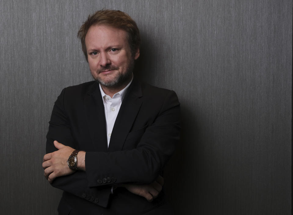"""Rian Johnson, writer/director of the film """"Knives Out,"""" poses for a portrait at the St. Regis Hotel during the Toronto International Film Festival, Sunday, Sept. 8, 2019, in Toronto. (Photo by Chris Pizzello/Invision/AP)"""
