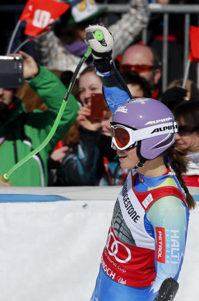 Slovenia's Tina Maze celebrates her fourth place after completing a women's World Cup super-G, in Garmisch-Partenkirchen, Germany, Sunday, March 3, 2013. (AP Photo/Marco Trovati)