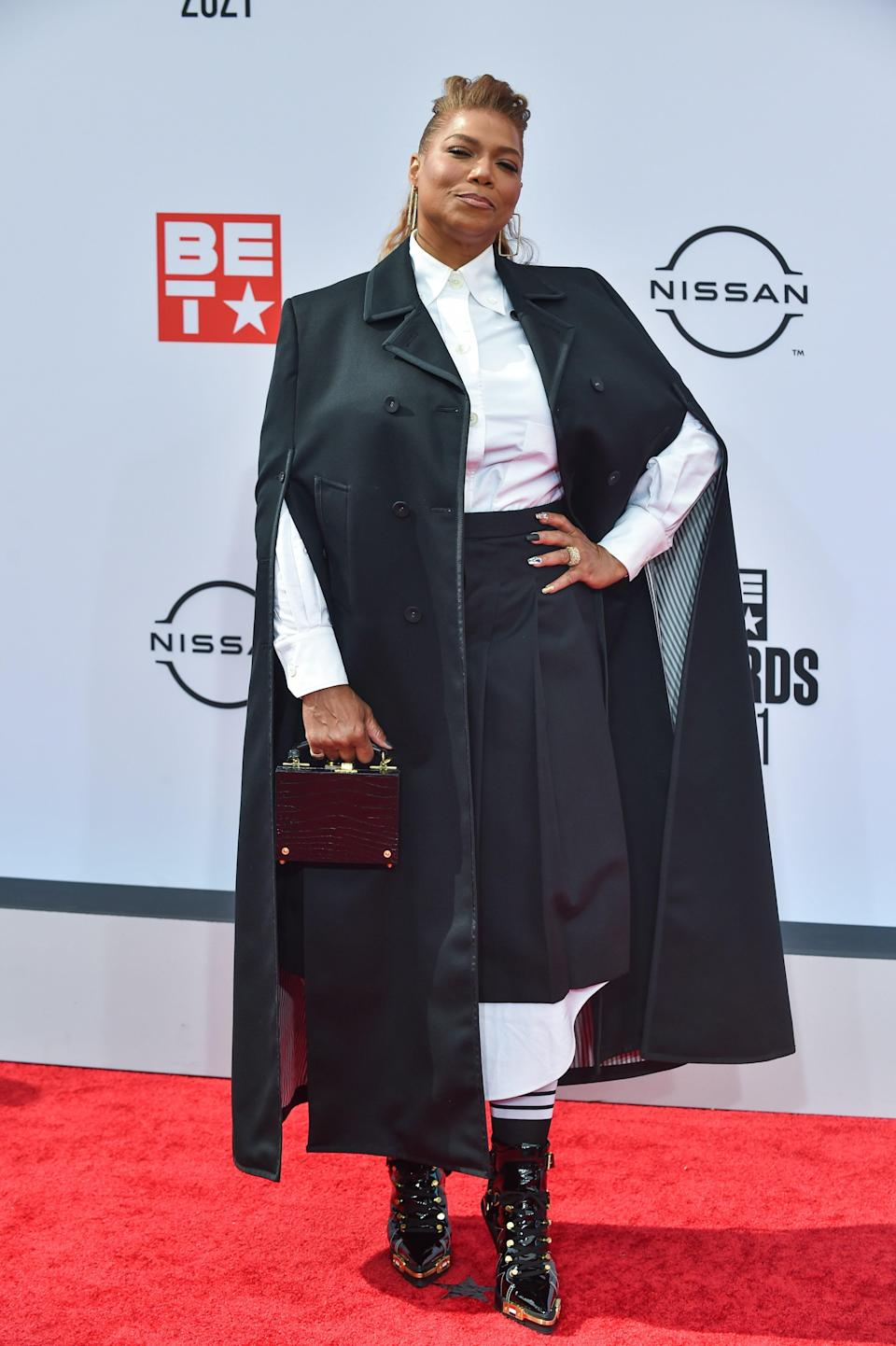 The honouree of the night turned up to the function in a Thom Browne cape and Oxford shirt-dress.