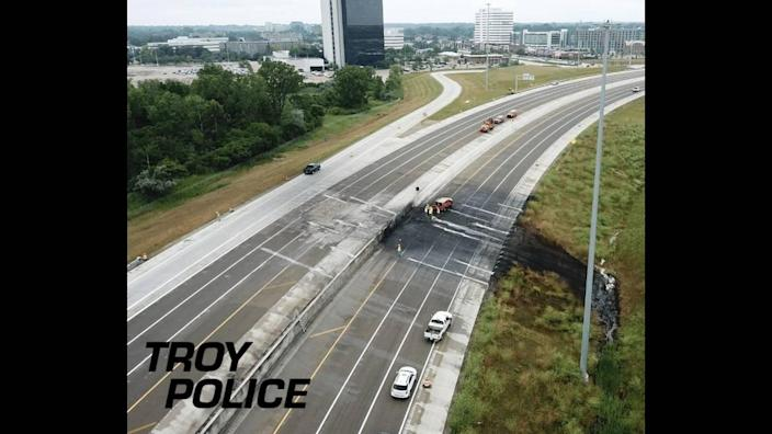 Fire damaged pavement across all travel lanes and spread down the shoulder of the interstate.