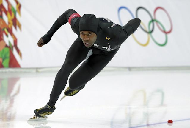 Shani Davis of the U.S. competes in the men's 1,000-meter speedskating race at the Adler Arena Skating Center during the 2014 Winter Olympics in Sochi, Russia, Wednesday, Feb. 12, 2014. (AP Photo/Matt Dunham)