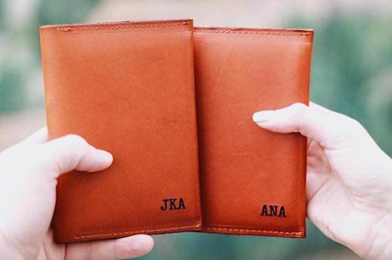 "Get them <a href=""https://www.etsy.com/listing/483062509/monogrammed-passport-cover-couples?ga_order=most_relevant&ga_search_type=all&ga_view_type=gallery&ga_search_query=couples%20passport%20holders&ref=sr_gallery-1-20&source=aw&utm_source=affiliate_window&utm_medium=affiliate&utm_campaign=us_location_buyer&awc=6220_1520864014_a004ba25d57a00a3d94a01a6a00b563a&utm_content=78888"" target=""_blank"">here</a>."