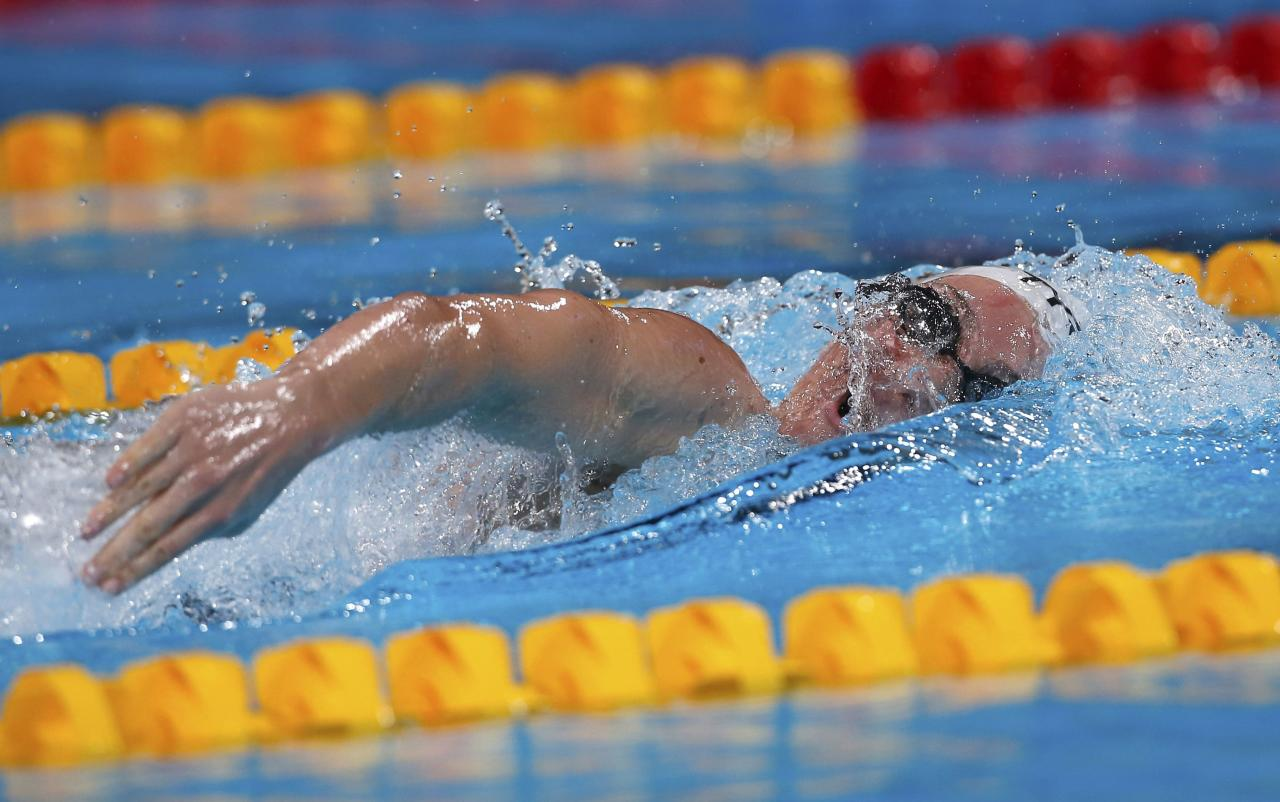 Camille Muffat of France competes in the women's 200m freestyle heats during the World Swimming Championships at the Sant Jordi arena in Barcelona in this July 30, 2013 file photo. French President Francois Hollande's office confirmed on March 10, 2015 that eight French nationals were among 10 killed in an accident involving two helicopters in Argentina. The Elysee Palace said in a statement that famed sailor Florence Arthaud, Olympic swimmer Muffat and boxer Alexis Vastine were among the dead. It added that the accident happened during the filming of a TV programme for the TF1 TV channel.    REUTERS/Albert Gea/Files (SPAIN  - Tags: SPORT SWIMMING DISASTER TRANSPORT OBITUARY ENTERTAINMENT)