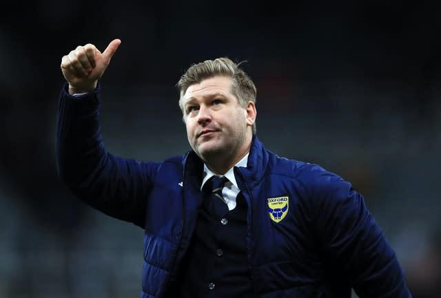 Karl Robinson's Oxford won five games in a row prior to shutdown to secure a play-off place (Owen Humphreys/PA)