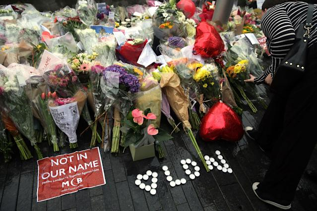 <p>People look at the floral tributes after a vigil for victims of Saturday's attack in London Bridge, at Potter's Field Park in London, Monday, June 5, 2017. Police arrested several people and are widening their investigation after a series of attacks described as terrorism killed several people and injured more than 40 others in the heart of London on Saturday. (Photo: Tim Ireland/AP) </p>