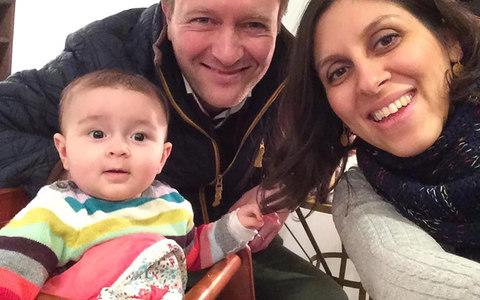 Nazanin Zaghari-Ratcliffe (R) posing for a photograph with her husband Richard and daughter Gabriella (L) - Credit: AFP