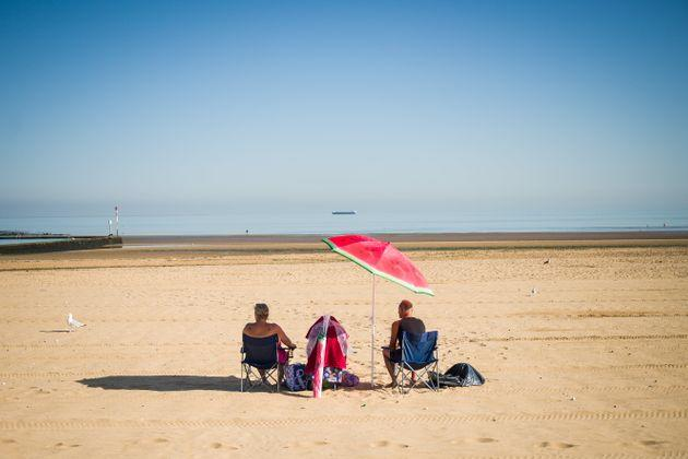 A couple stake an early claim on the best spot on the beach on August 07, 2020 in Margate