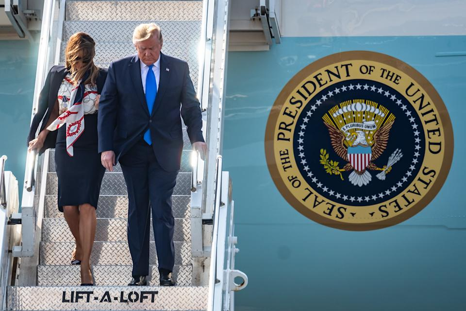 Stepping off: President Trump and First Lady Melania disembark Air Force One on Monday morning. (SWNS)