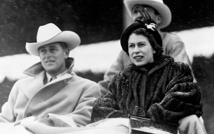 In a photo from 1951, the then Princess Elizabeth and the Duke of Edinburgh watched a 'stampede' rodeo staged especially for them in Calgary, Alberta, during their tour of Canada. - PA